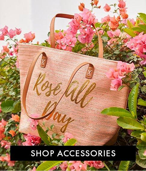 large pink beach bag with text : rose all day.
