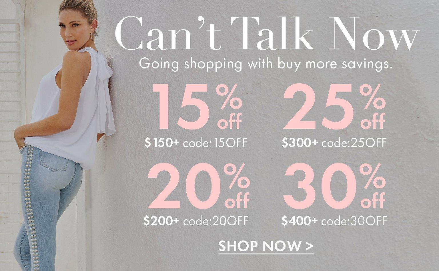 left model leaning against the wall wearing a white mock-neck chiffon sleeveless top and pearl studded jeans. text overlay explaining the four tiers of the sale.