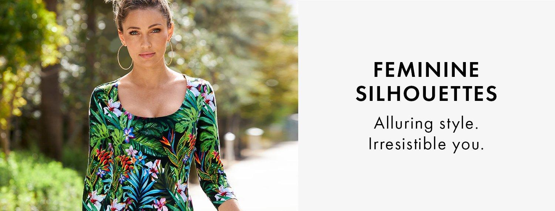 model wearing a jungle print scoop-neck top.