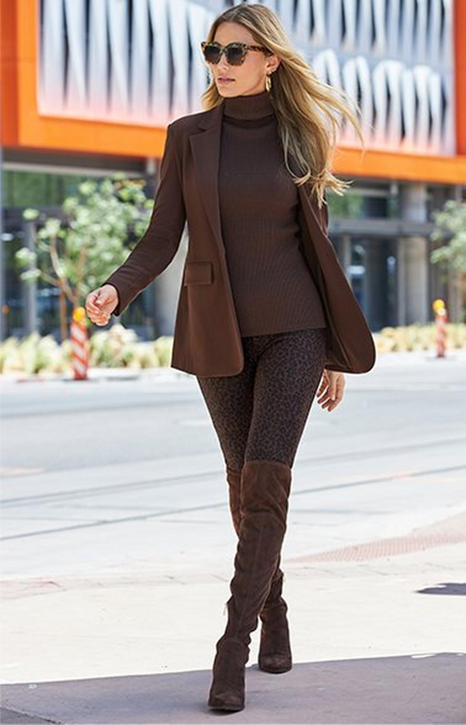 model wearing a chocolate brown blazer, chocolate brown ribbed turtleneck sweater, brown animal print leggings, and chocolate brown over-the-knee suede boots.