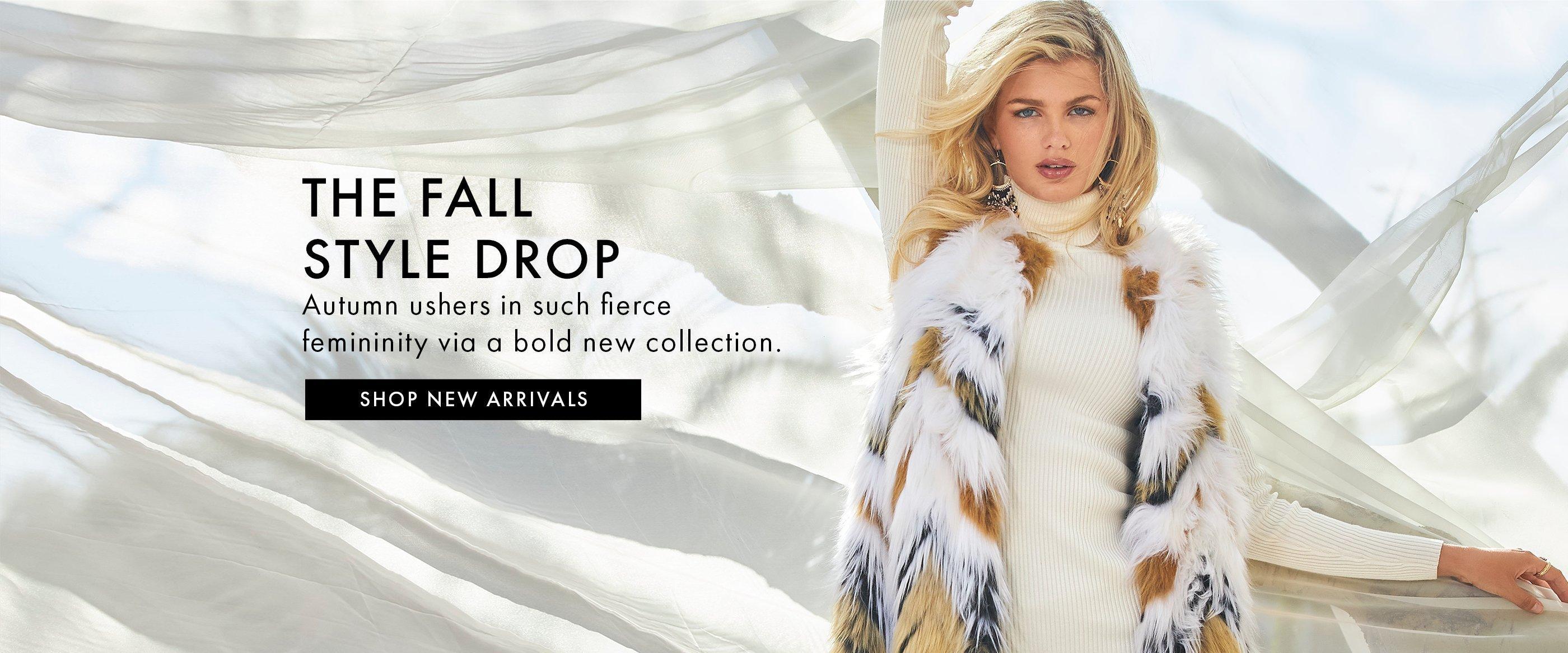 model wearing a faux fur chevron long vest and white turtleneck sweater.