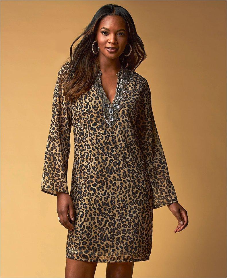 model wearing a leopard dress with embellished neckline.