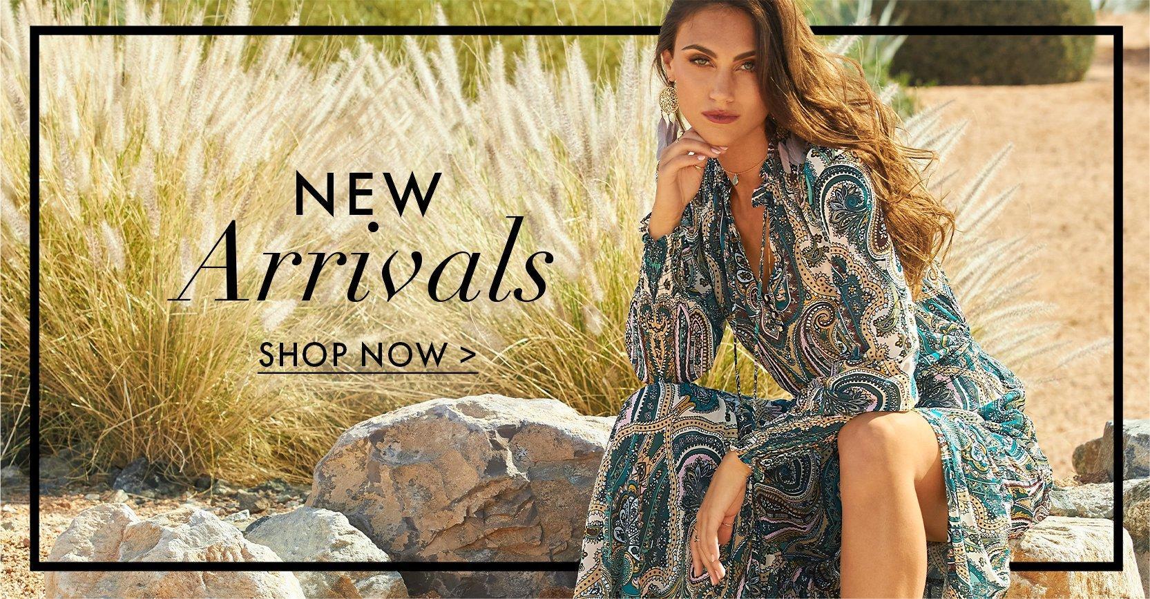 model wearing a paisley print long sleeve boho maxi dress.