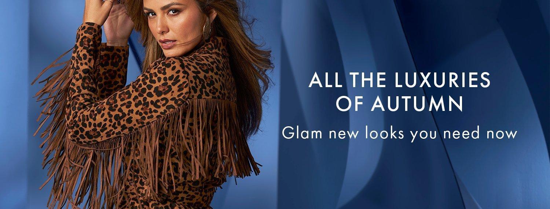 model wearing a leopard print suede fringe jacket.