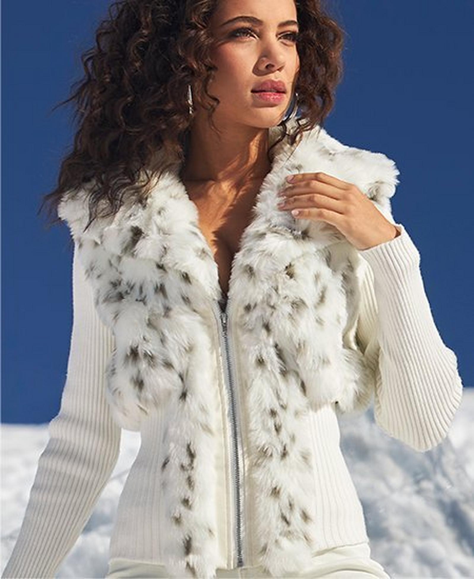 model wearing a white cardigan with white snow leopard faux-fur.