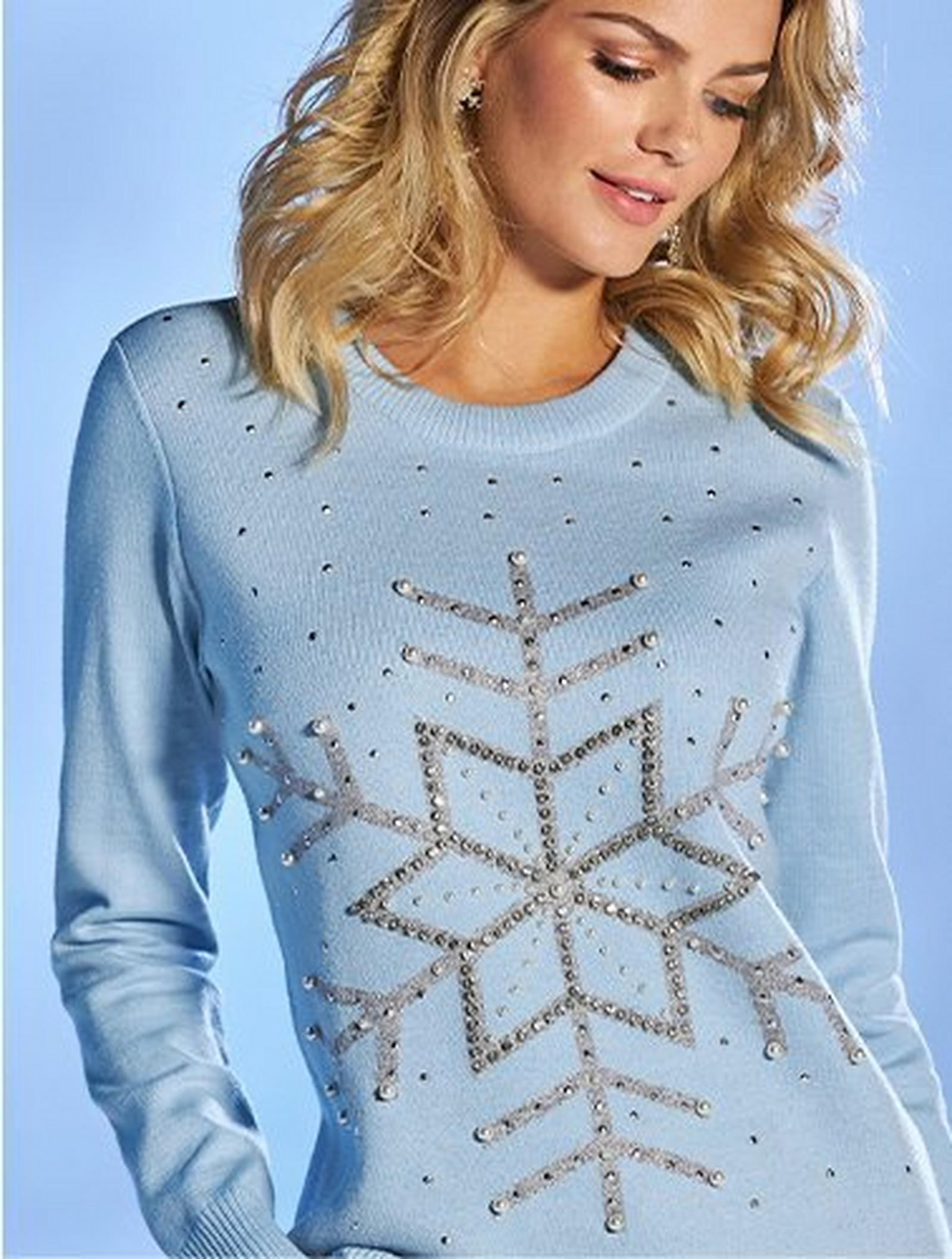 model wearing a light blue snowflake embellished pullover sweater.