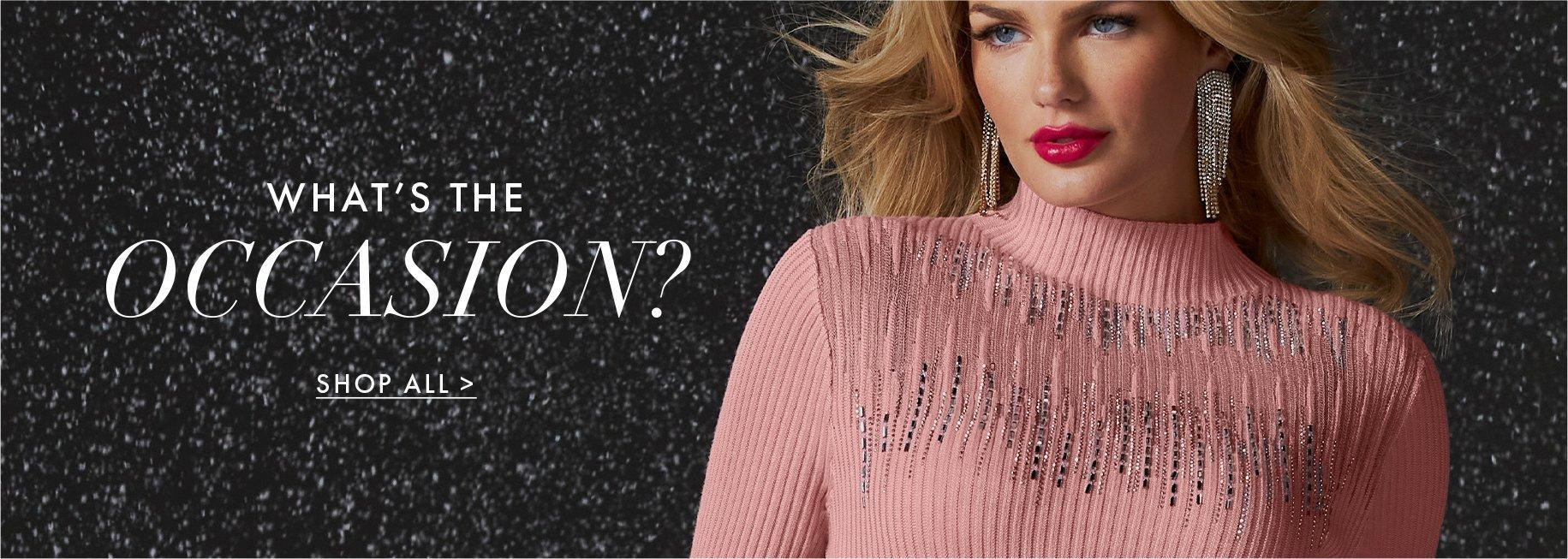 model wearing a light pink rhinestone embellished turtleneck sweater.