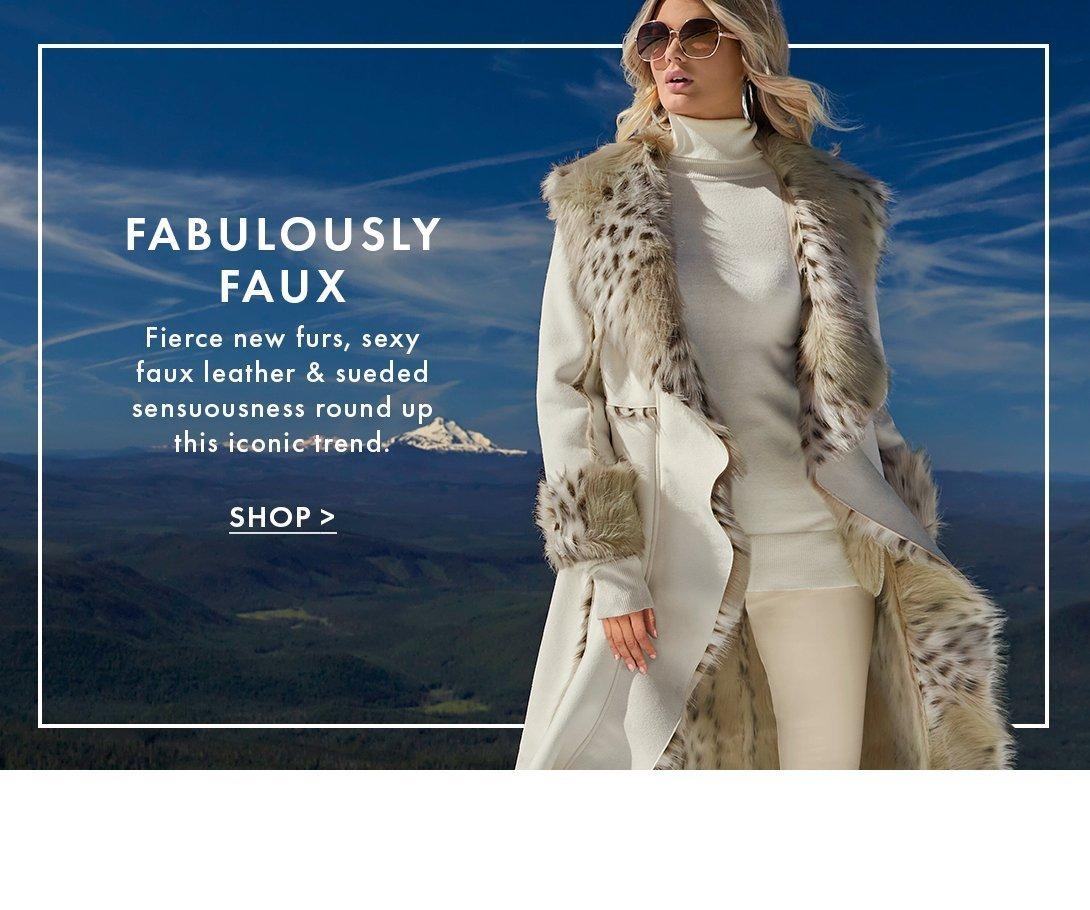 model wearing a white long cascading coat with animal print faux fur, white ribbed turtleneck sweater, off-white leggings, and taupe over-the-knee boots.