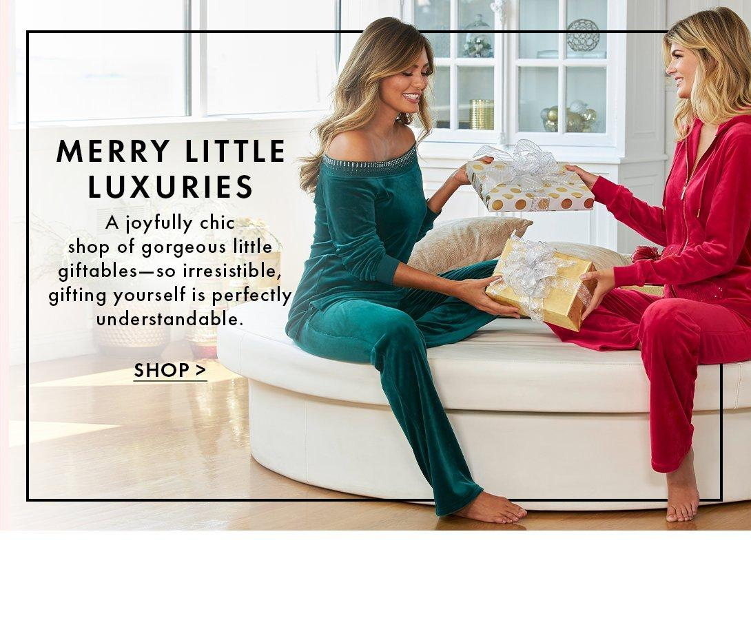 left model wearing a green embellished off the shoulder long-sleeve top and matching pants. right model wearing a red zip-up velour jacket and matching pants.