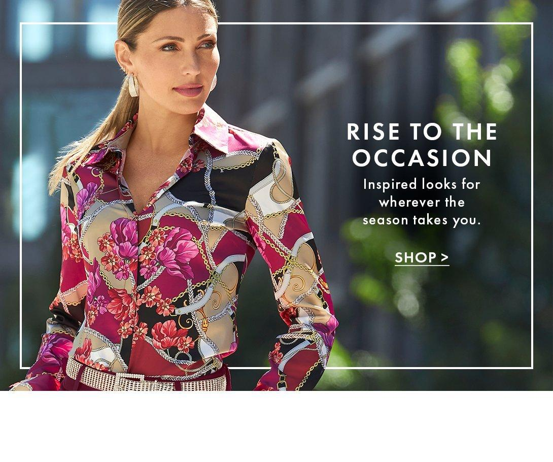 model wearing a multicolored floral and chain printed button-down long-sleeve top.