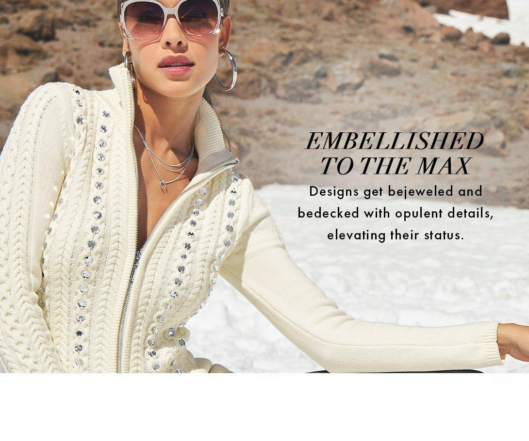 model wearing an off-white rhinestone embellished cable-knit zip-up jacket.