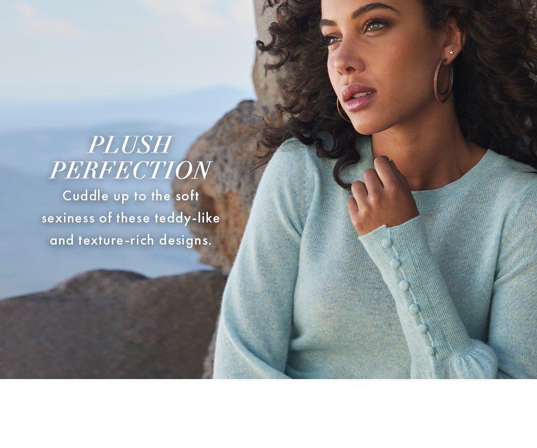 model wearing a light blue puff-sleeve button-cuff sweater.