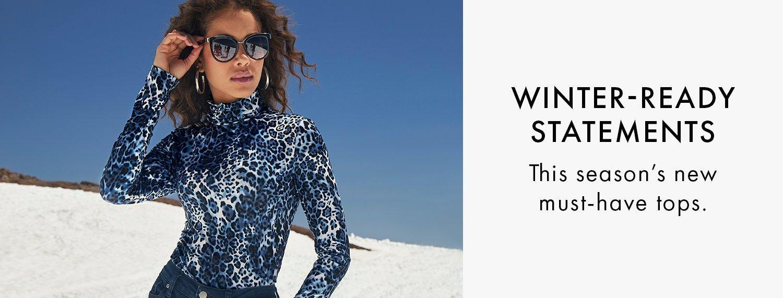 model wearing a blue animal print long-sleeve turtleneck top.