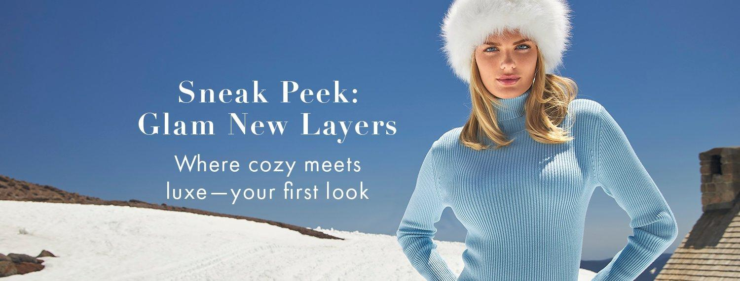 model wearing a light blue ribbed turtleneck sweater and a white faux fur hat.