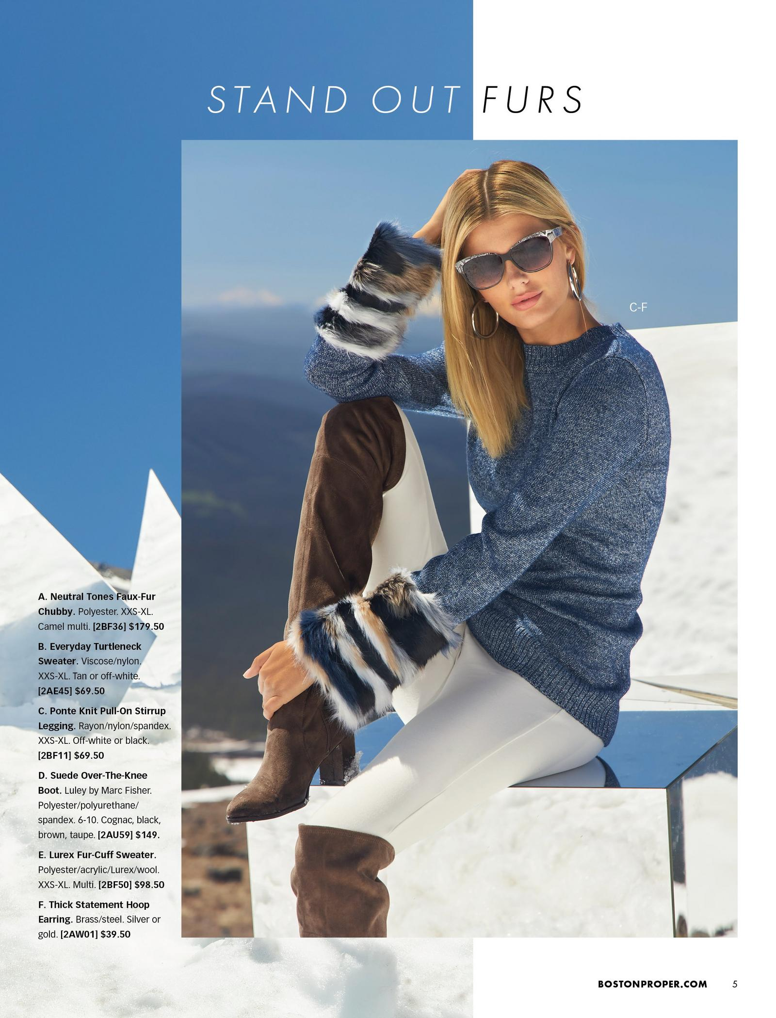 model wearing a navy sweater with faux-fur multicolored cuffs, white leggings, silver hoop earrings, and brown over-the-knee boots.