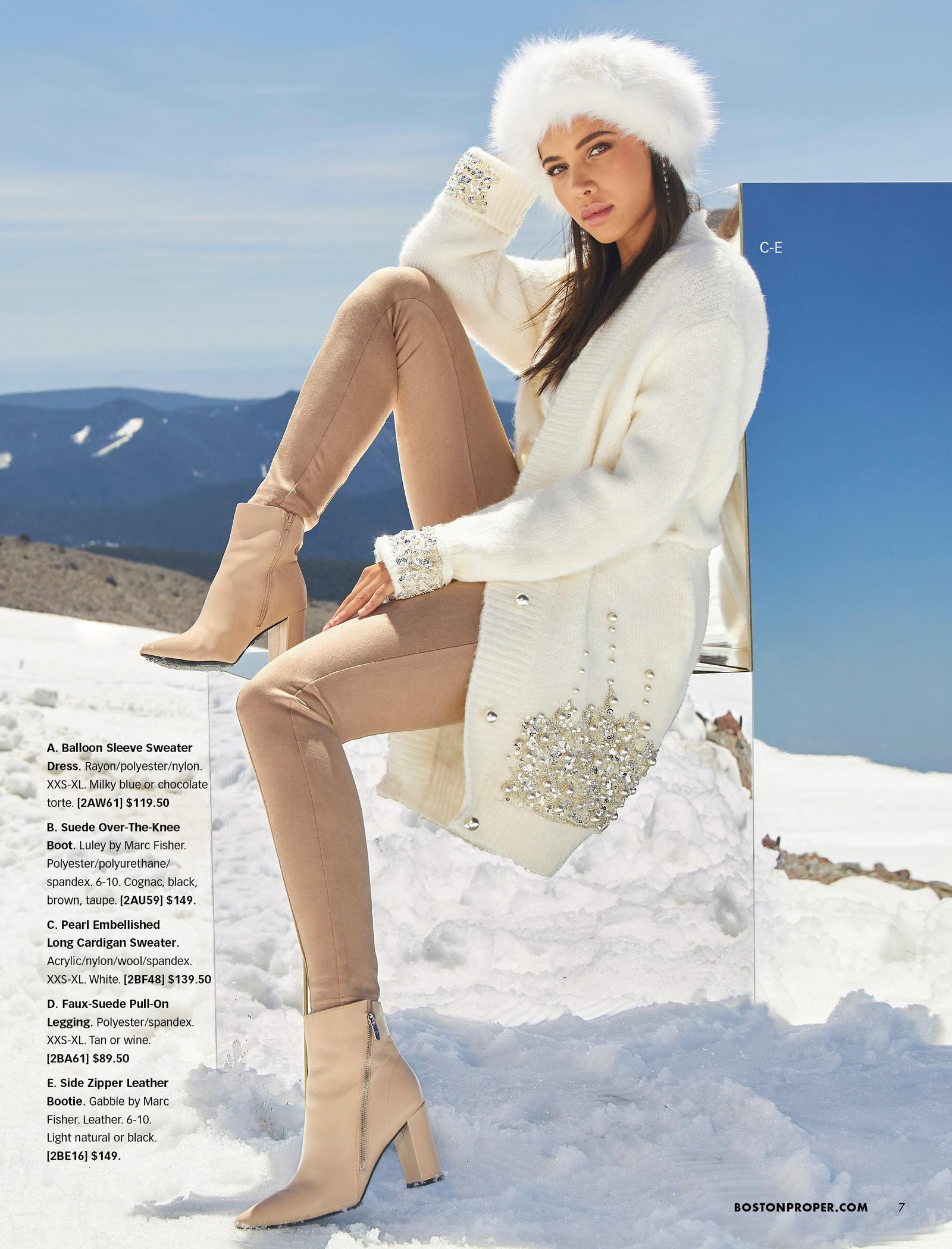 model wearing a white faux fur hat, white plush cardigan with pearl embellishments, tan suede leggings, and tan booties.