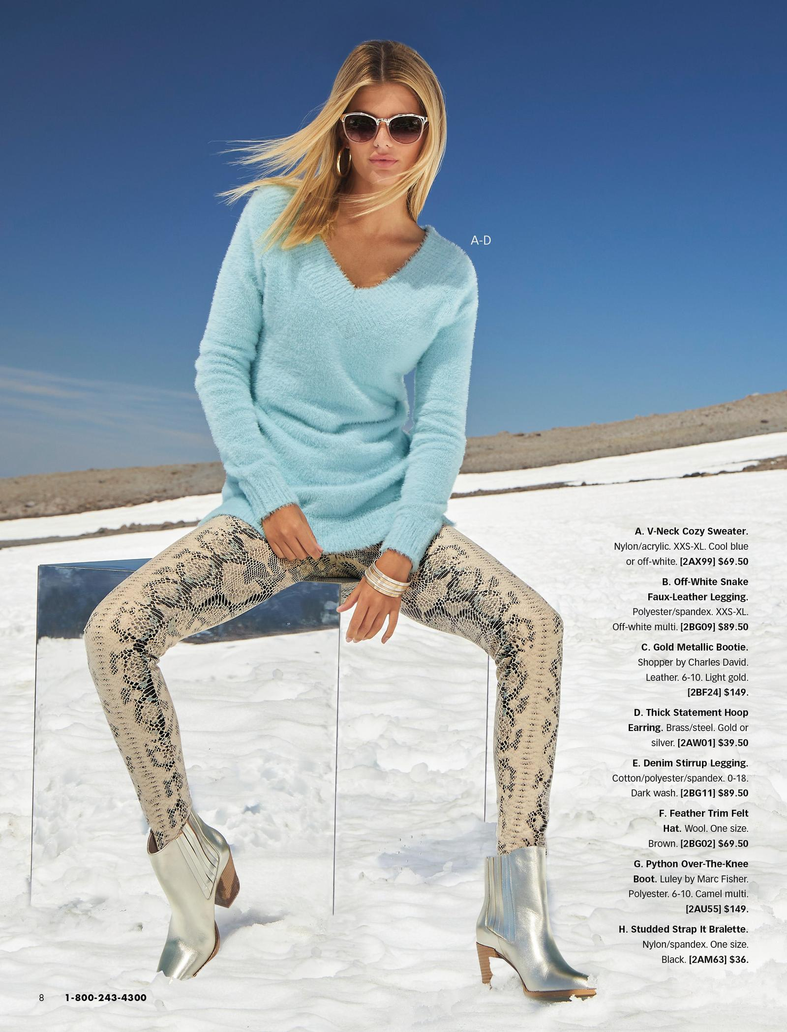 model wearing a light blue plush v-neck sweater, off-white snake print faux-leather leggings, and silver booties.