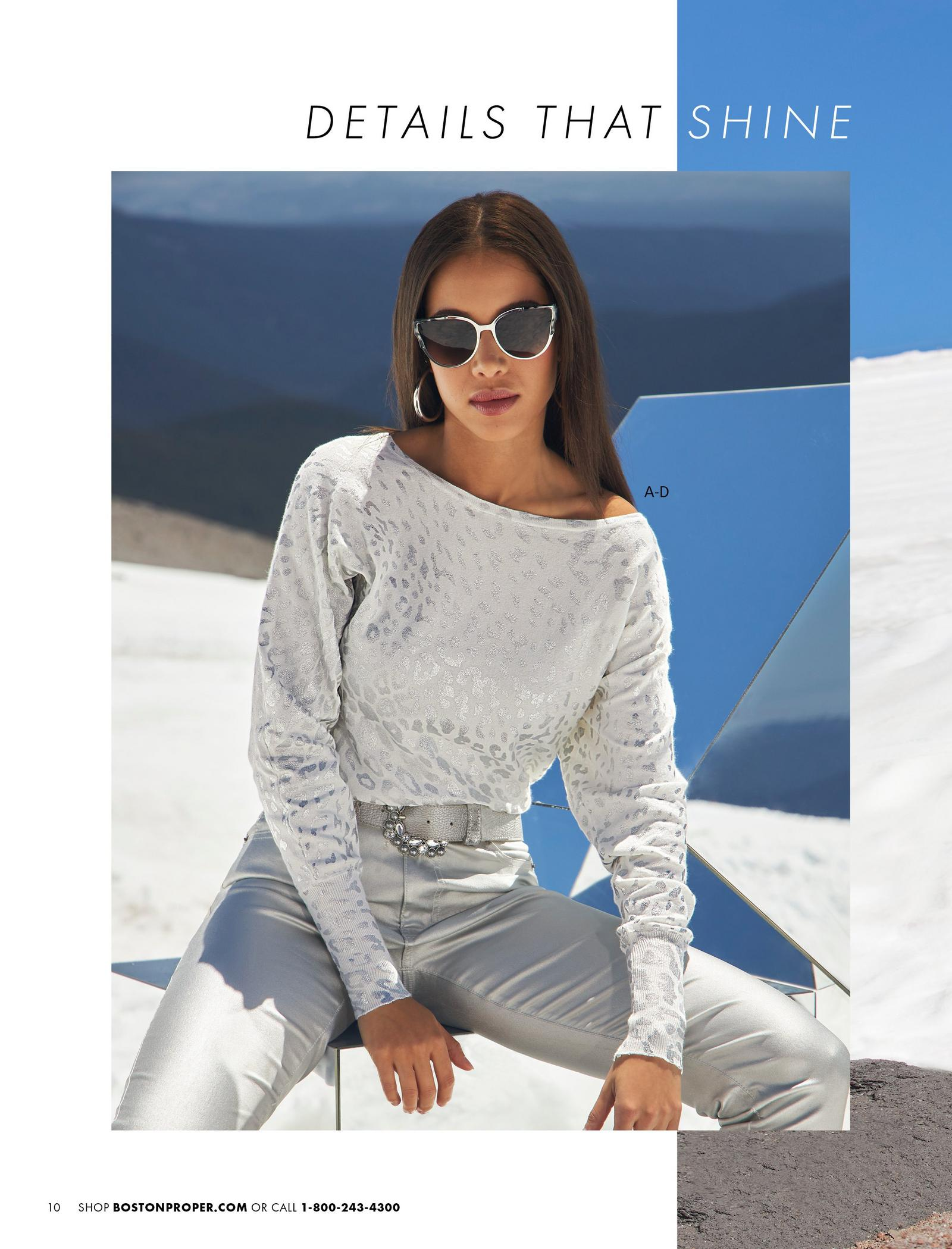 model wearing a silver foil white animal print slouchy sweater, silver pearl embellished belt, and silver coated jeans.