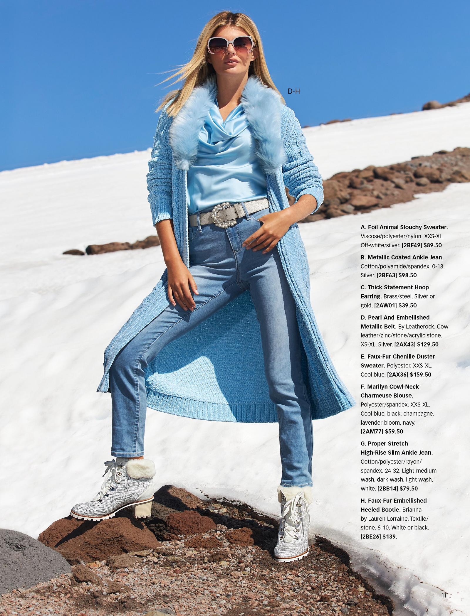 Model wearing a light blue chenille duster with light blue faux-fur collar, light blue cowl-neck top, pearl embellished silver belt, jeans, and silver faux-fur lace-up booties.