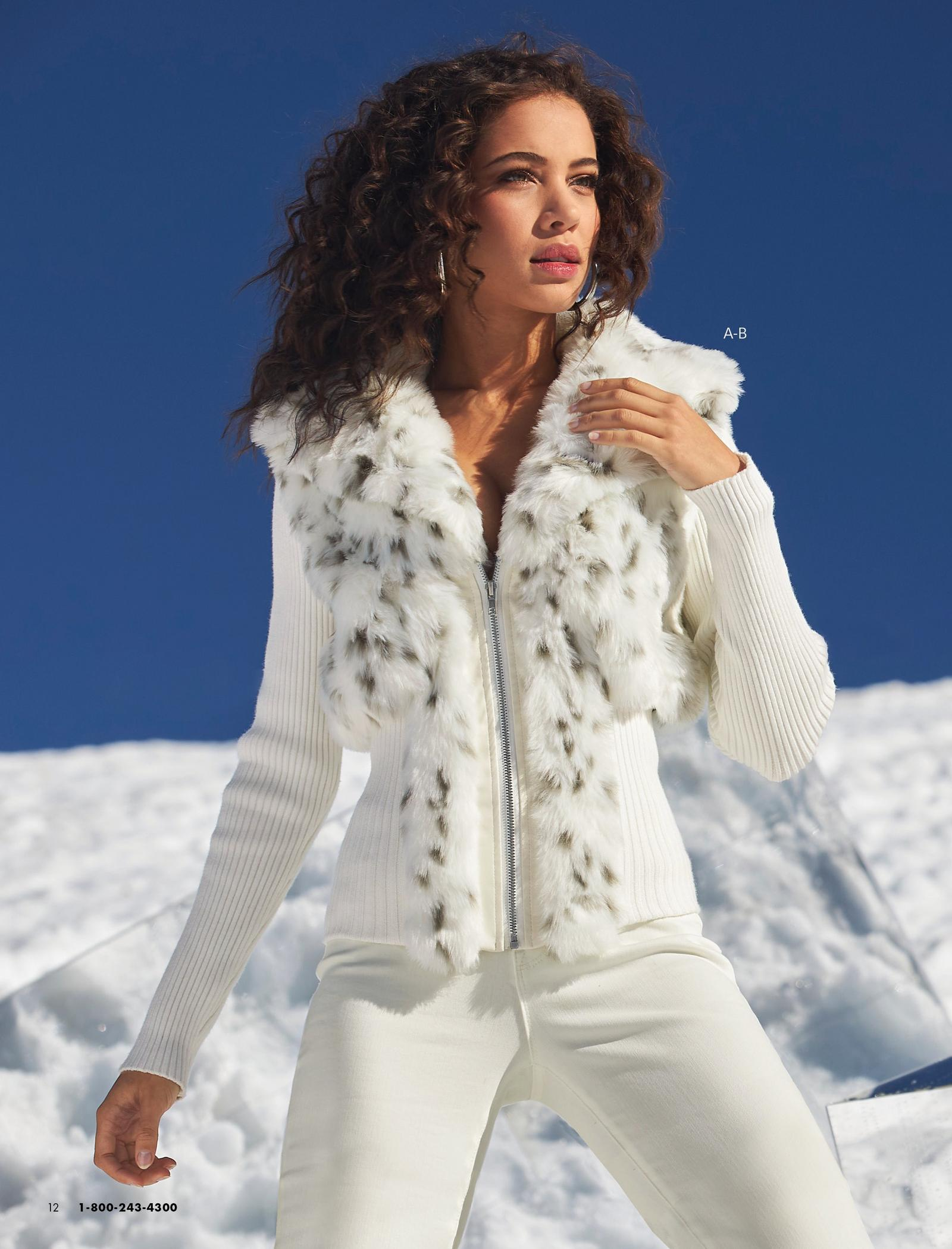 model wearing a white ribbed cardigan with snow leopard faux-fur and white bootcut jeans.