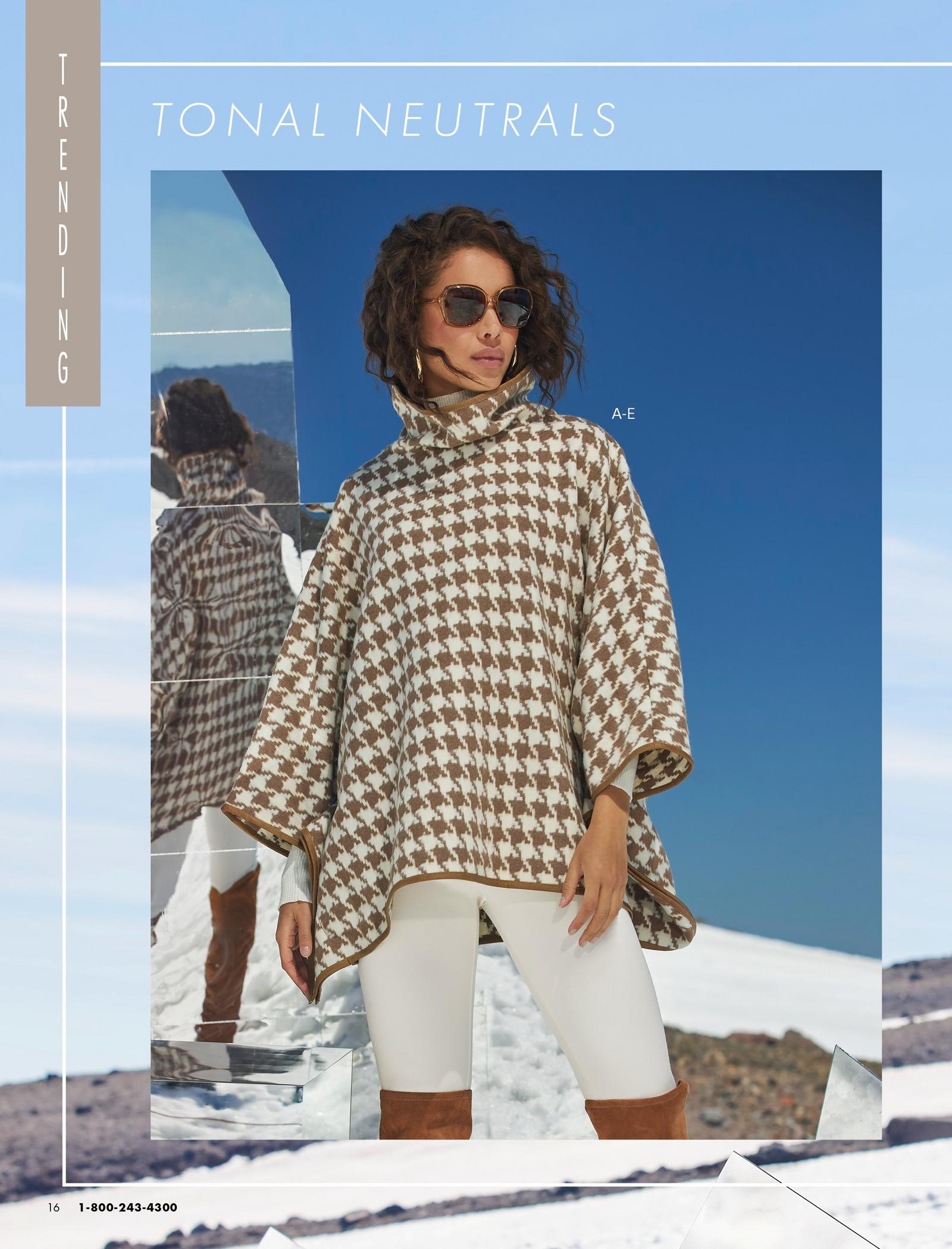 model wearing a brown and white houndstooth faux-leather tipped turtleneck poncho, white leggings, silver hoop earrings, and brown over-the-knee suede boots.