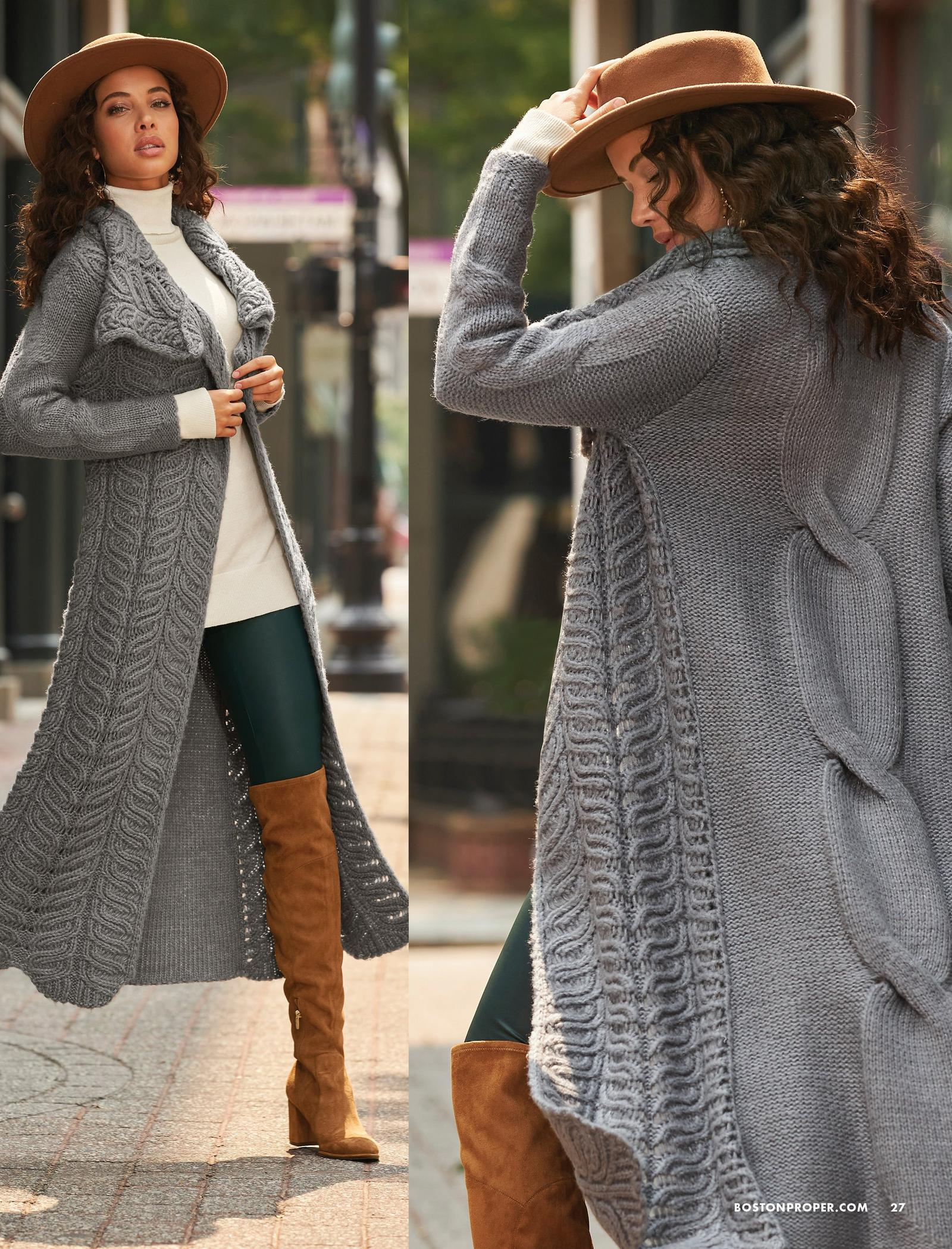 model wearing a gray cable-detail long duster sweater, off-white turtleneck sweater, dark green faux-leather leggings, brown felt hat, and light brown over-the-knee suede boots.
