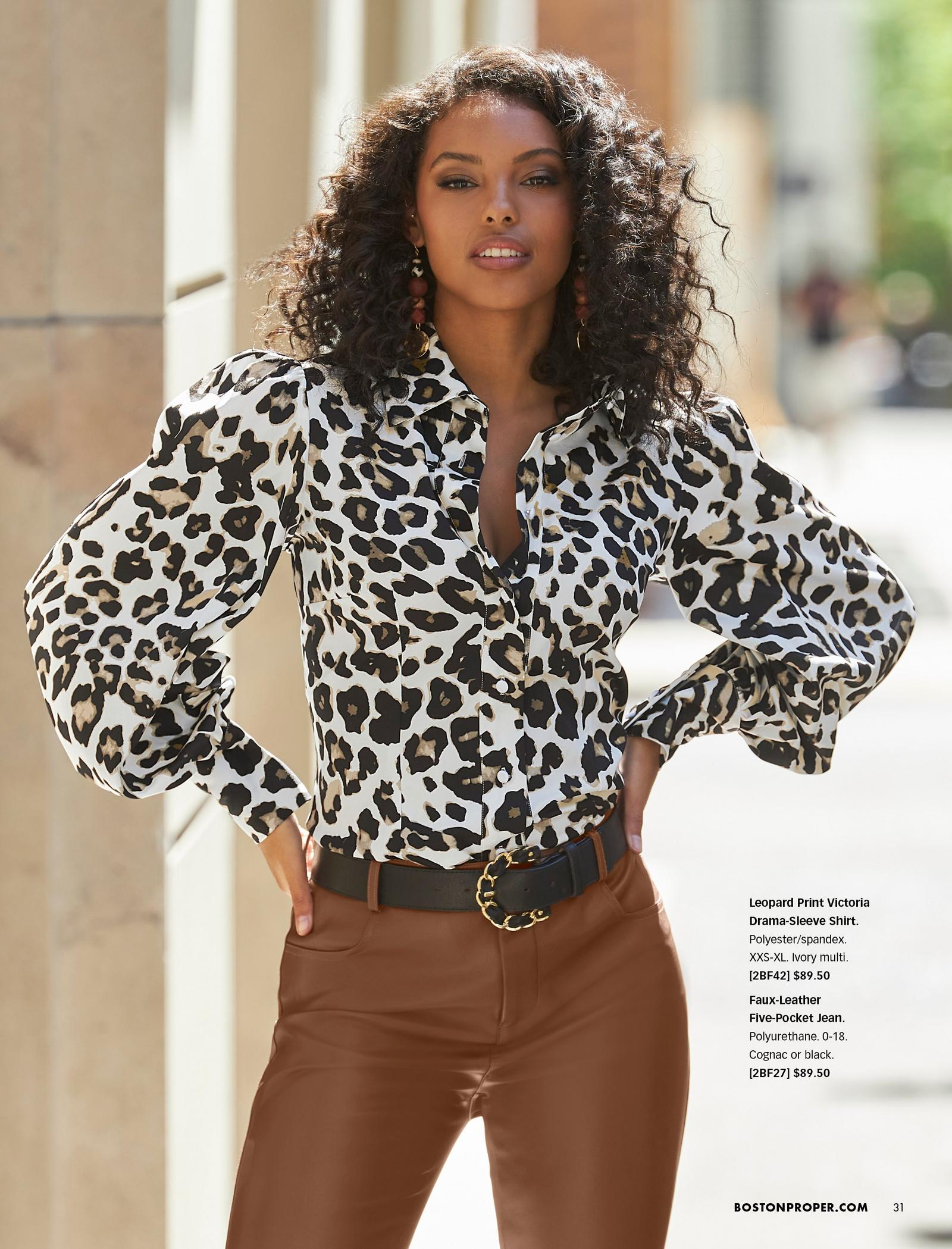 model wearing a leopard print drama-sleeve button-down shirt, black belt, and brown faux-leather jeans.