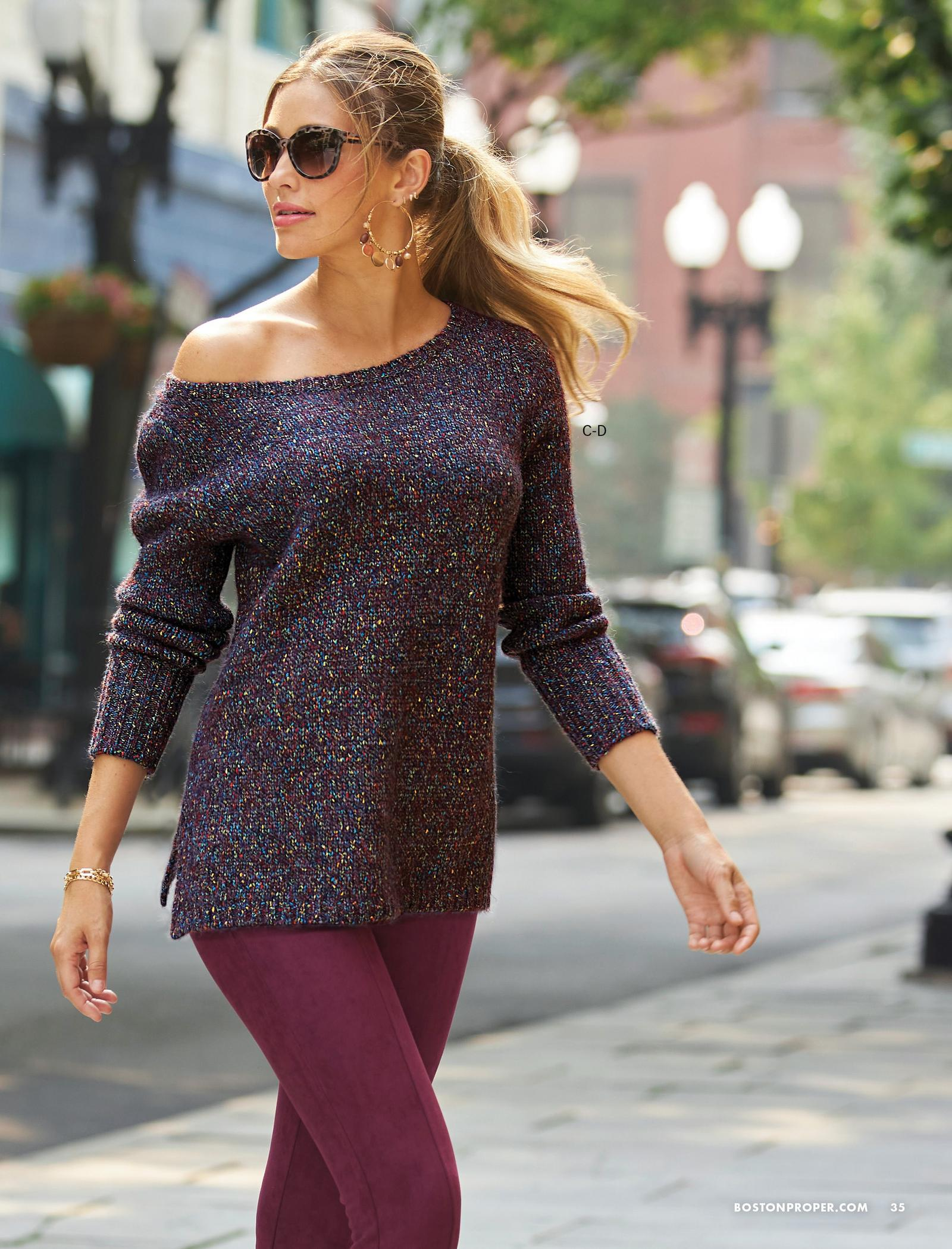 model wearing a marled slouchy tunic sweater and wine faux-suede leggings.