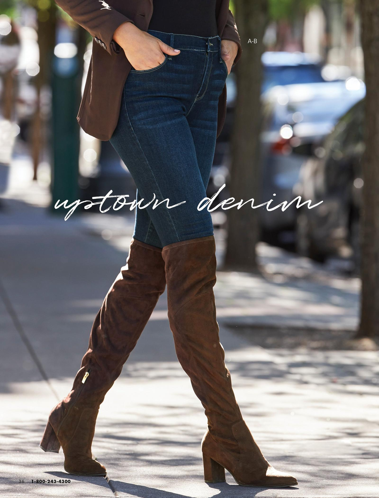 model wearing denim stirrup leggings and brown over-the-knee suede boots.