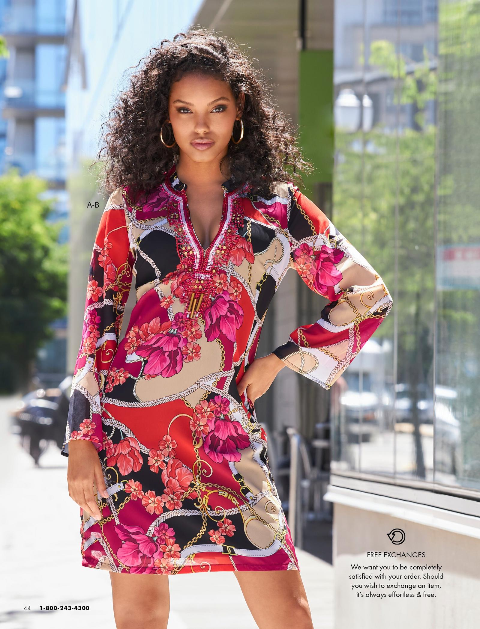model wearing a multicolored floral chain print embellished long-sleeve shift dress and gold hoop earrings.