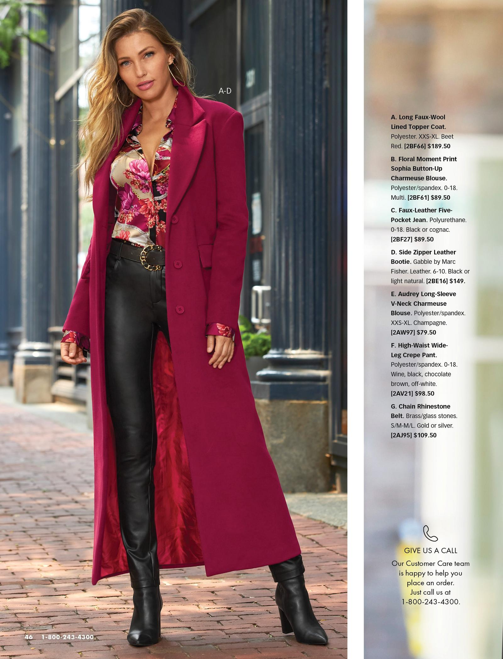 model wearing a beet red long faux-wool topper coat, multicolored floral chain print button-down blouse, black belt, black faux-leather jeans, and black leather booties.