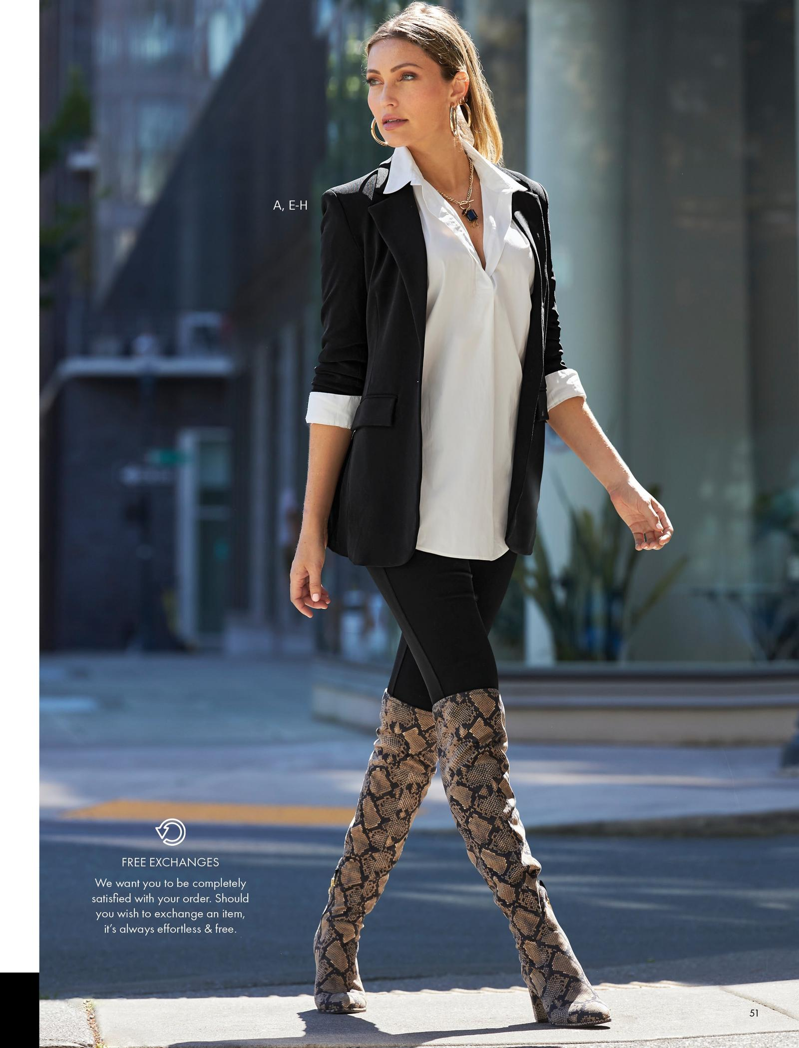 model wearing a black blazer, white tunic blouse, black leggings, gold hoop earrings, and python print over-the-knee boots.