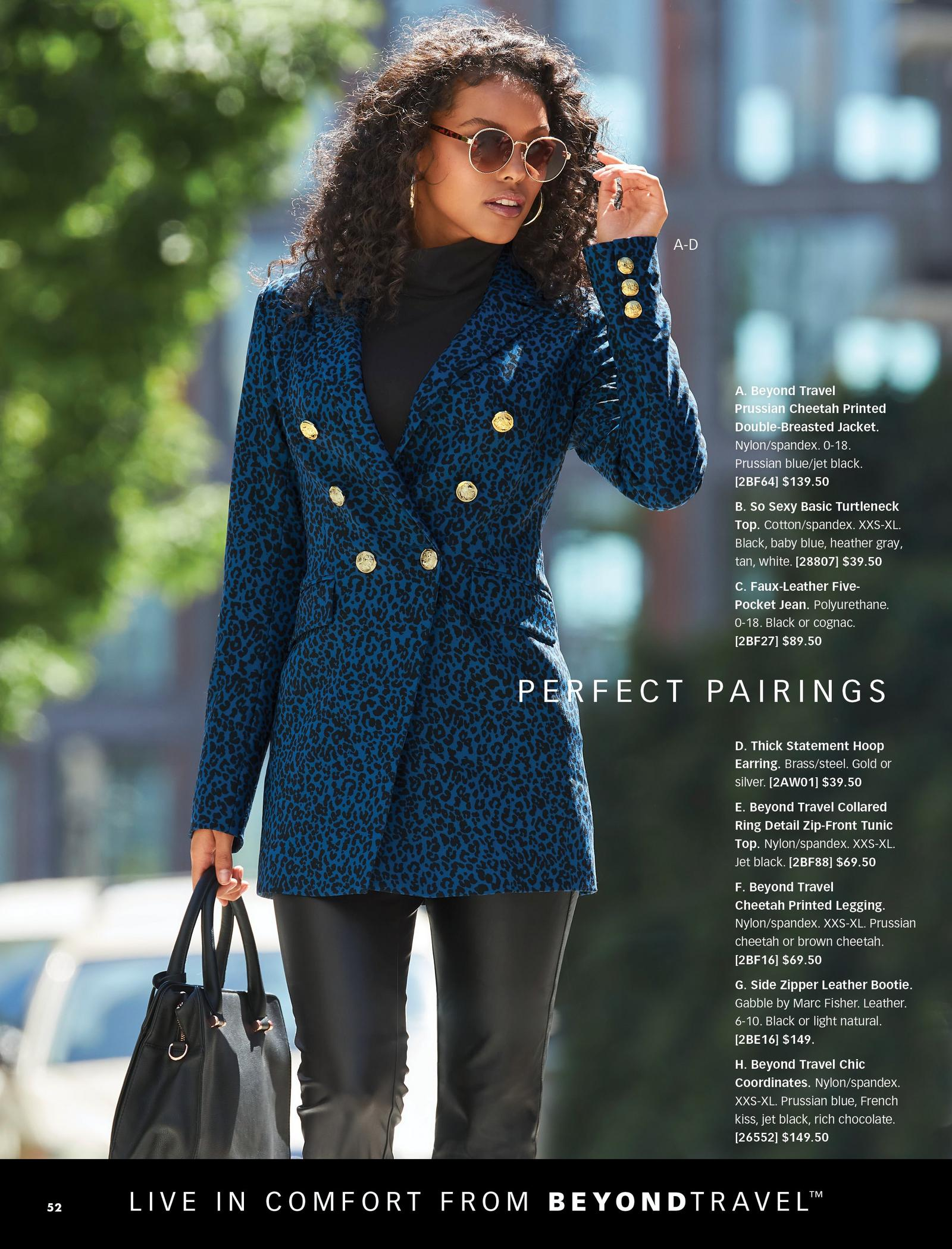 model wearing a blue animal print double-breasted jacket, black turtleneck top, black faux-leataher jeans, and gold hoop earrings.