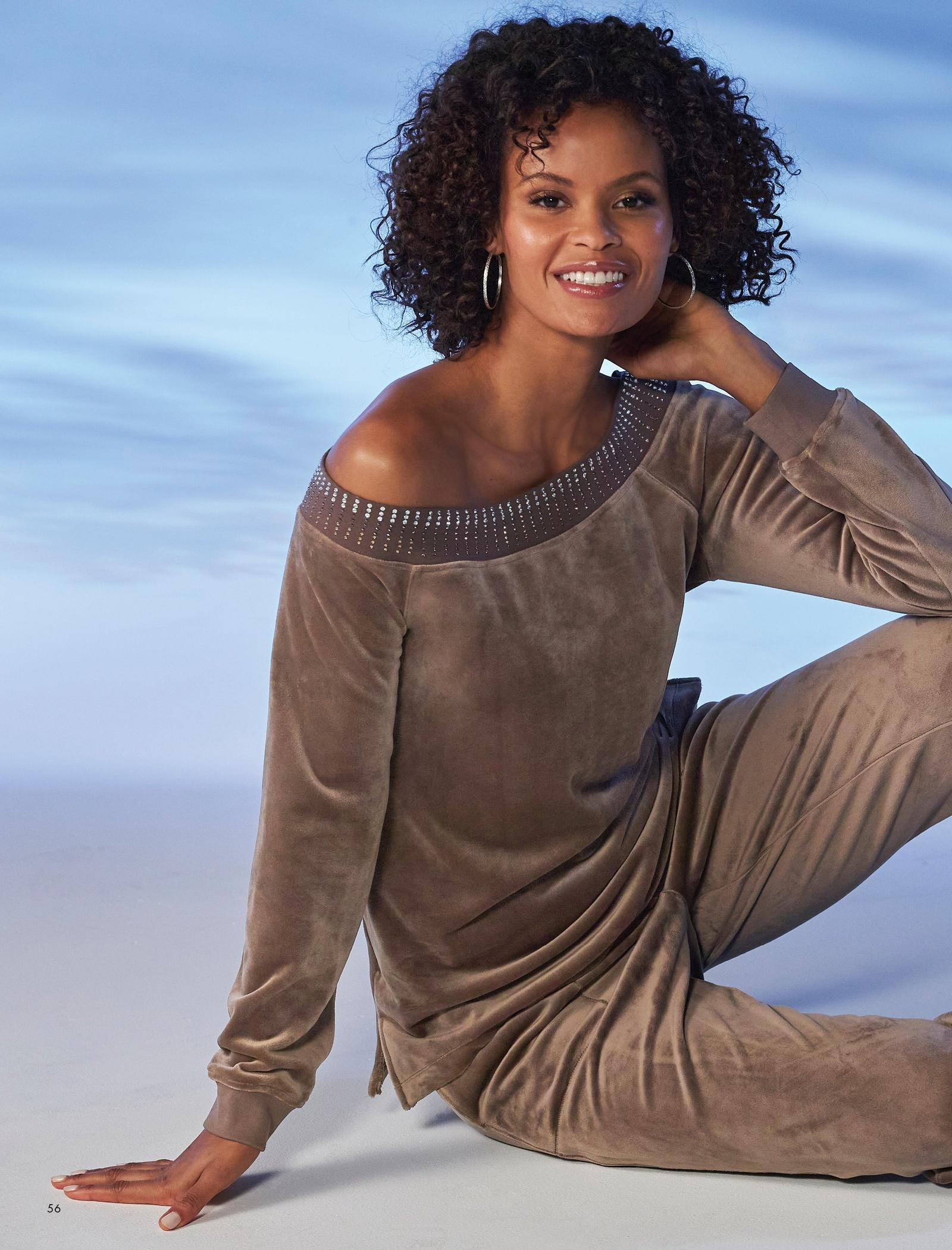 model wearing a taupe velour embellished top and matching joggers.