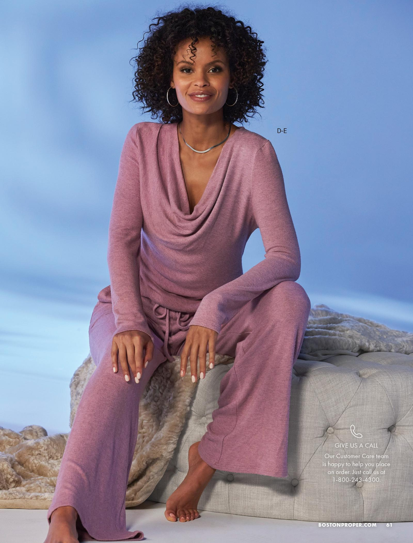 model wearing a pink cowl-neck long-sleeve top and matching wide-leg lounge pants.