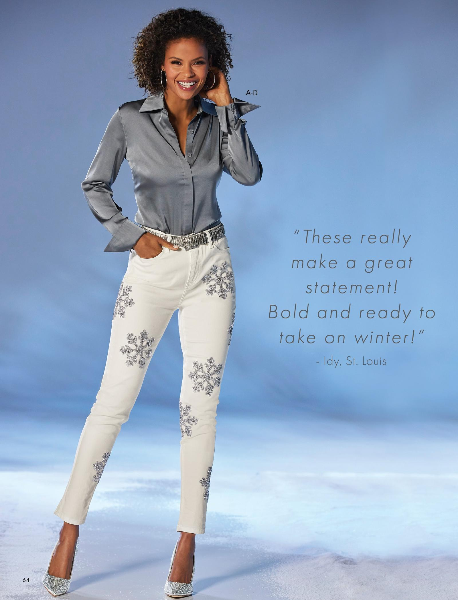 Model wearing a gray long-sleeve button-down blouse, silver chain belt, white jeans with snowflake embellishments, and silver embellished pumps.