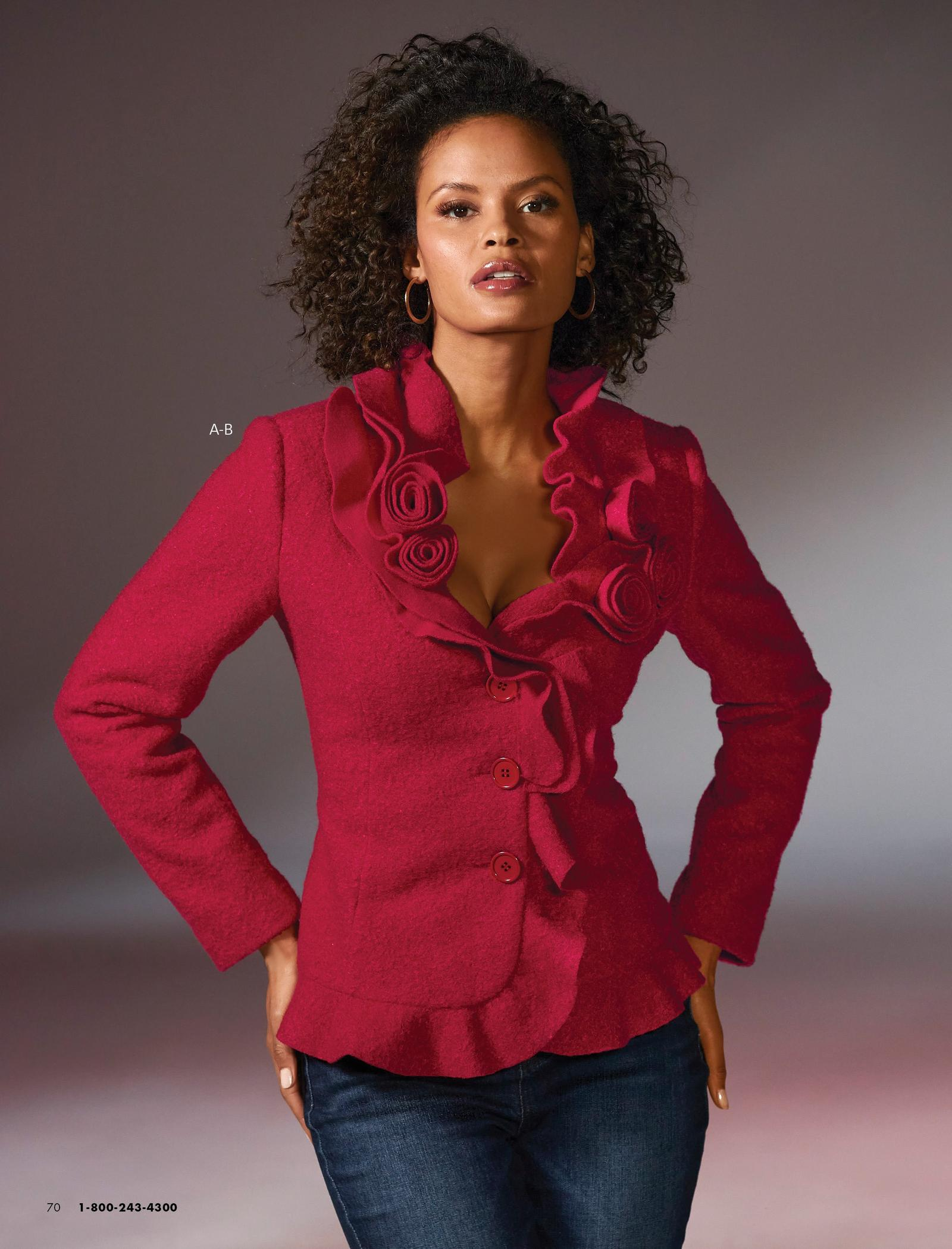 model wearing a red rosette & ruffle jacket and jeans.