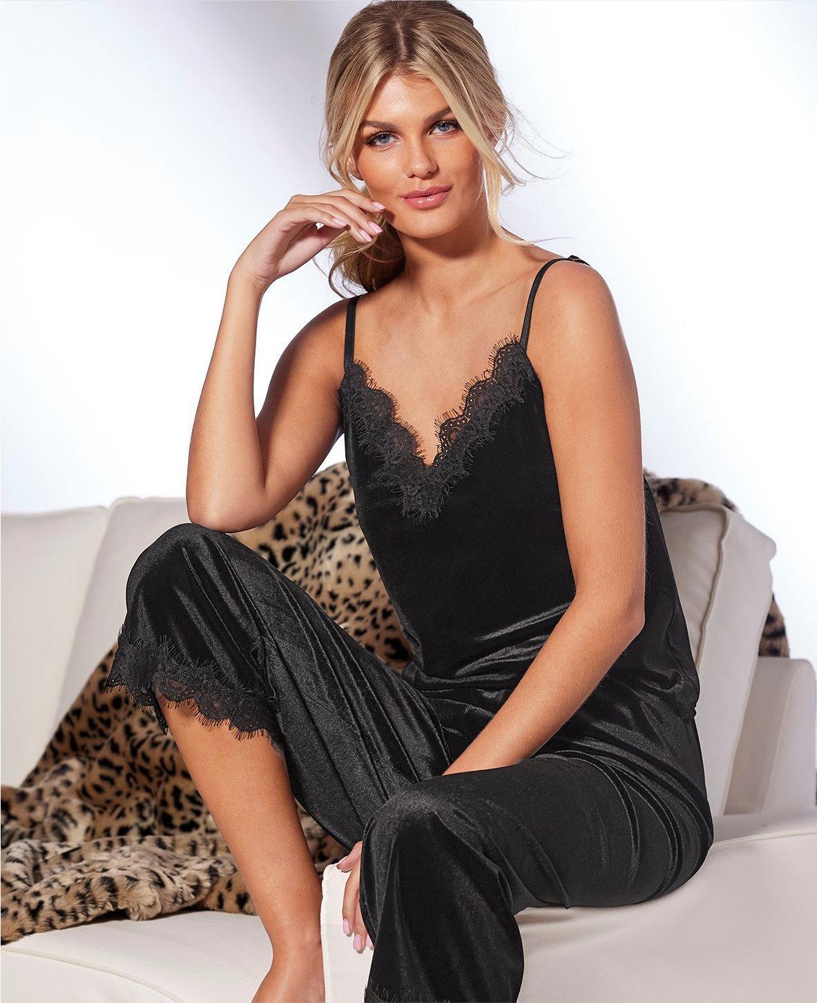 model wearing a black lace sleep set.