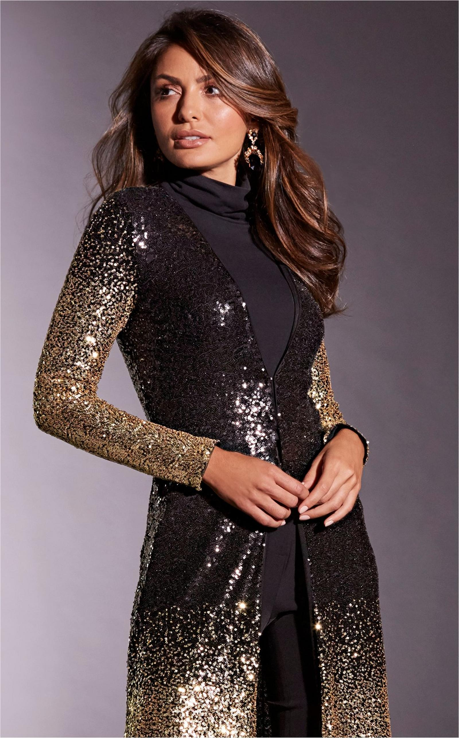 model wearing sequin black and gold duster over black turtleneck.
