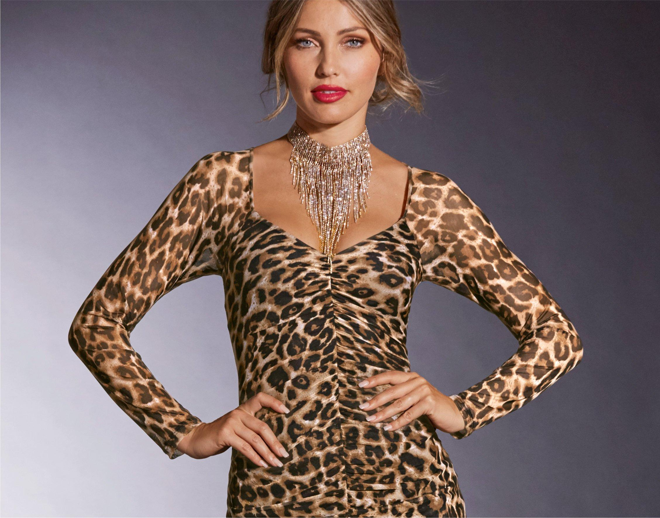 model wearing cheetah print dress with large fringe statement necklace.