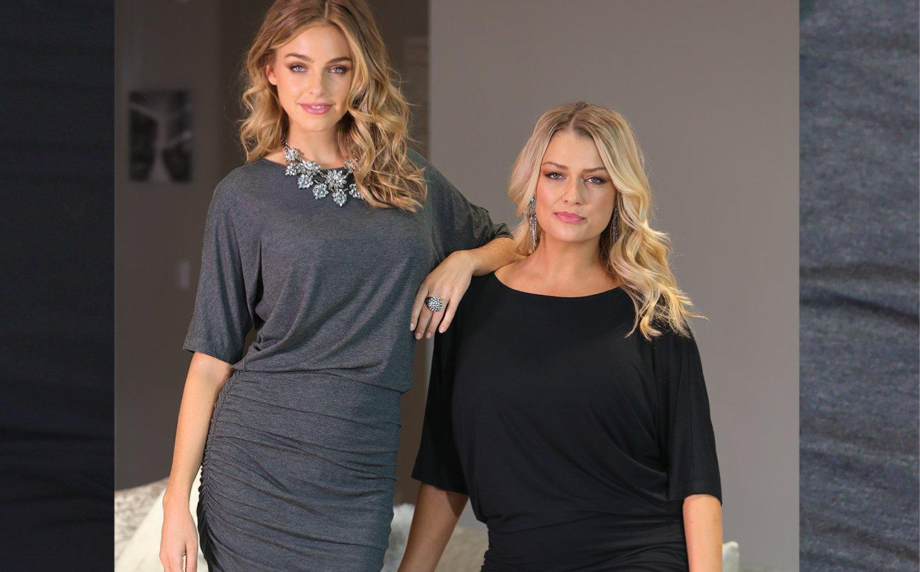 left: left model wearing gray blouson dress with large silver statement necklace, right model wearing black blouson dress. right text: beyond basics effortless essentials.