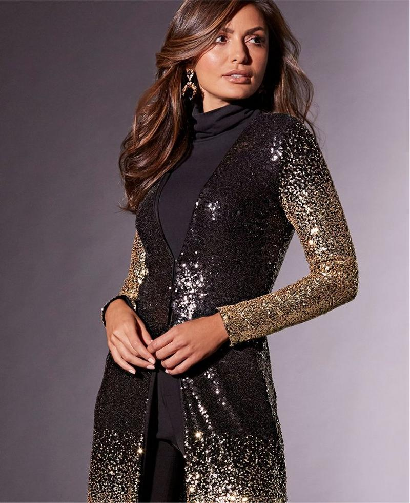 model wearing sequin gold and black ombre duster over black turtleneck.