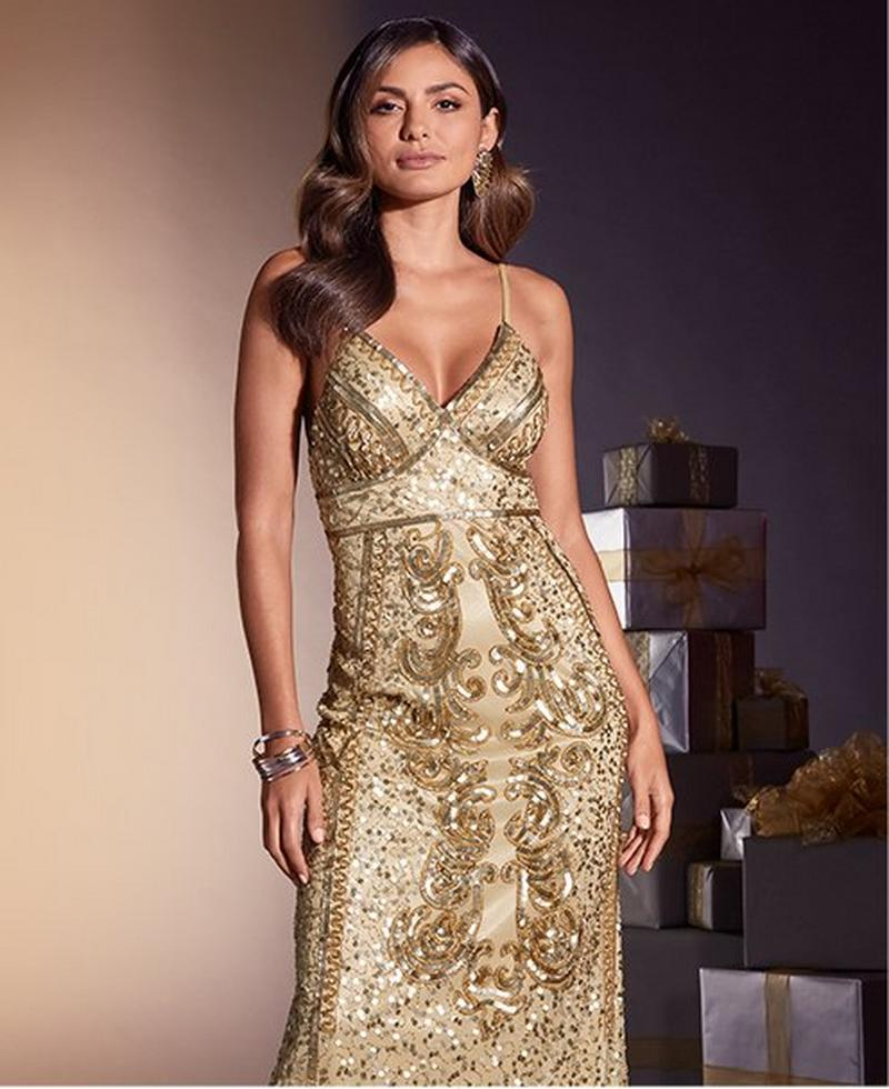 model wearing gold sequin maxi dress