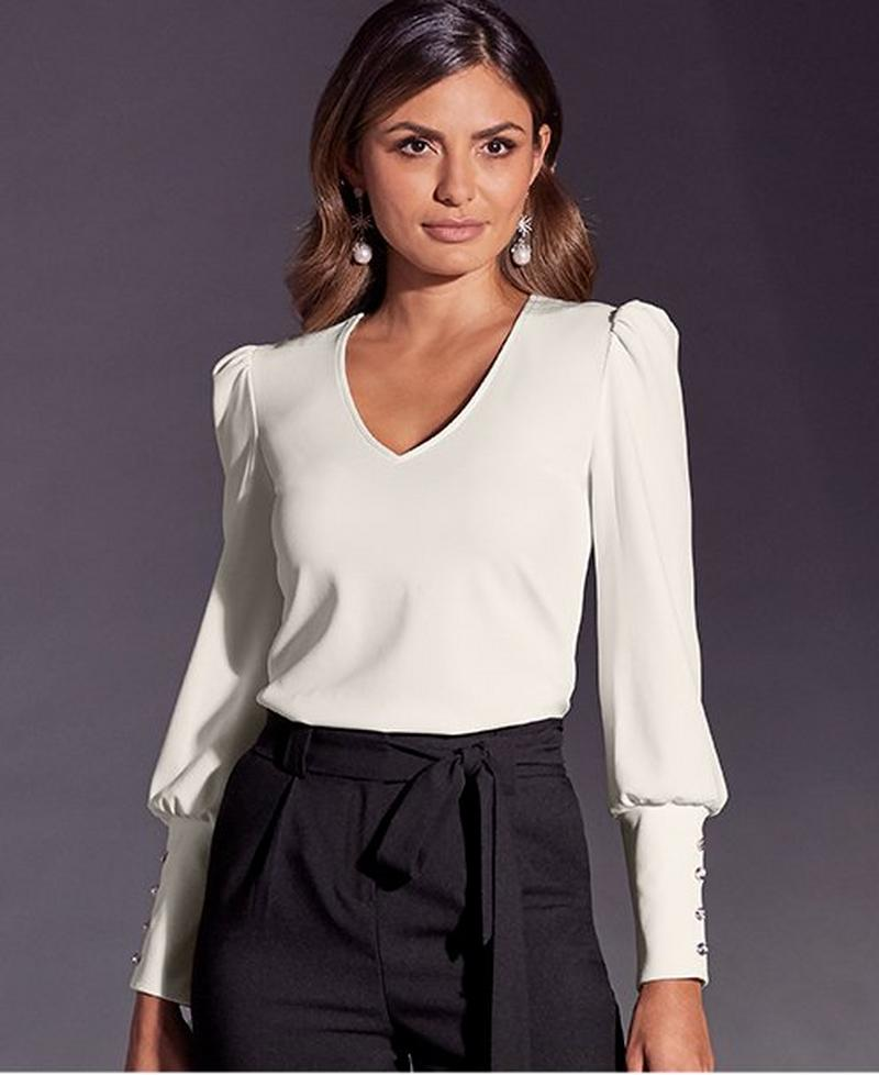 model wearing white v-neck blouse with black tie waist pants