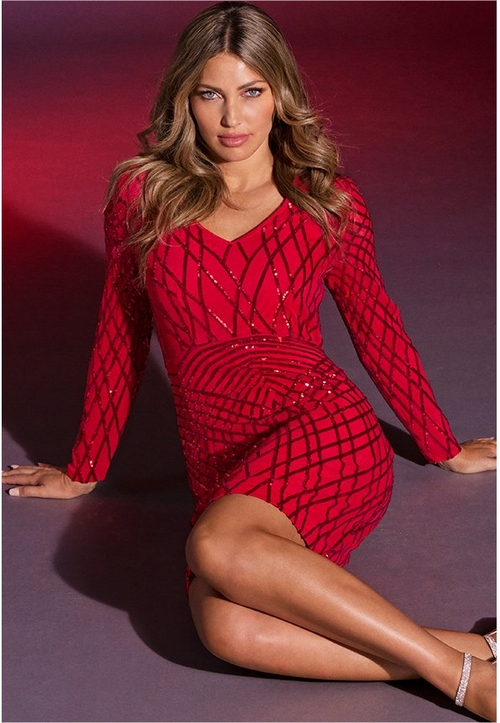 model lounging in red sequin long sleeve dress