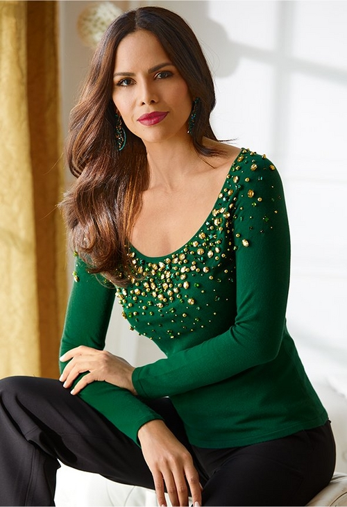 model wearing green sweater with sequins