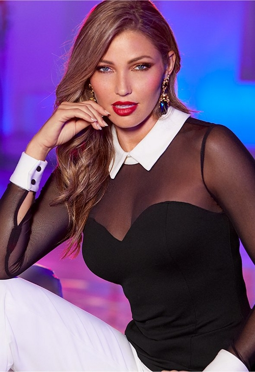 model wearing illusion black top with white collar and cuffs