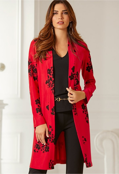 model wearing red floral cardigan over black tank top and black jeans with gold belt.p