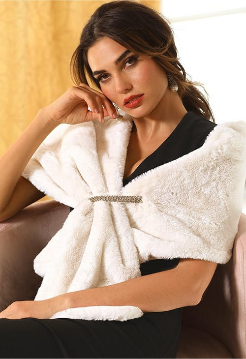 model wearing white faux fur embellished shawl.