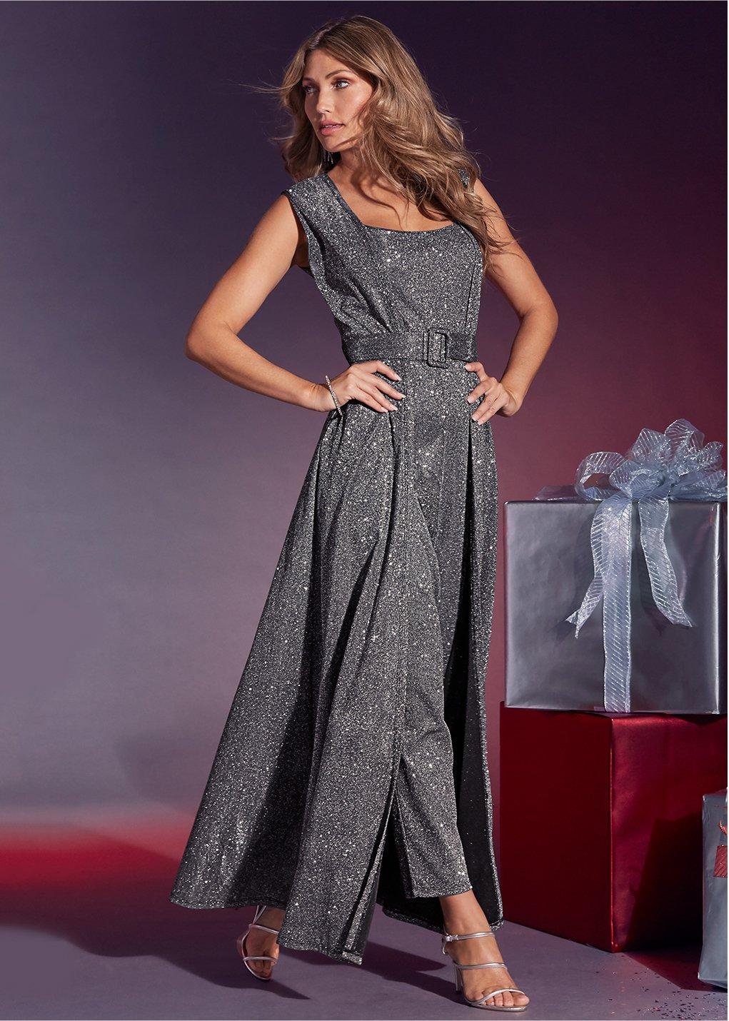 model wearing a sparkly belted jumpsuit in gray
